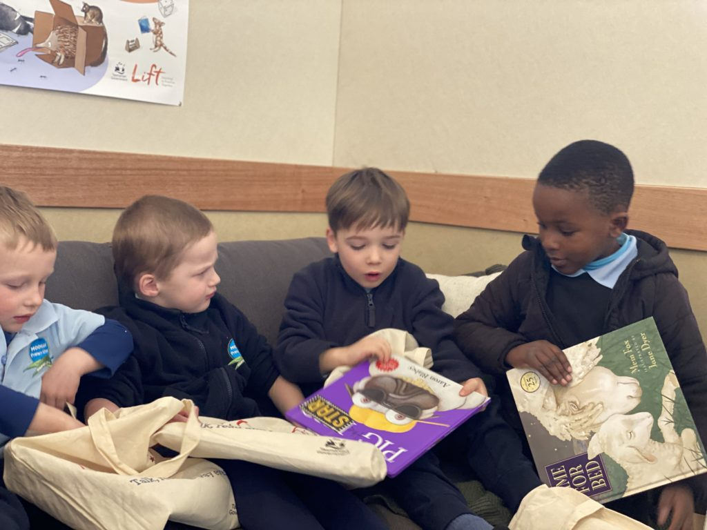 Kids opening library bags